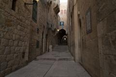 Boy Skips Down An Alley