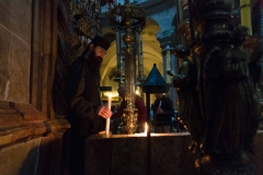 Priest Lighting Candles