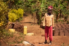Little Girl Working In The Field