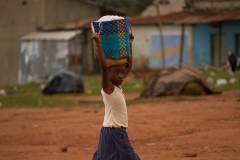 Girl Carrying A Basket Home