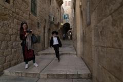 Jewish Boy Running Down The Alley
